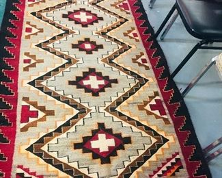 Native American Rug . Red Represents  a Powerful Color . The Crosses represent North South East and West .