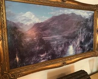 LARGE FRAMED MOUNTAIN SCENE IN LAVENDER TONES, WATERFALL AND TINY CROSS IN LOWER LEFT OF PICTURE