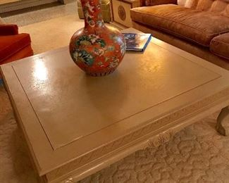 LARGE CREAM COLOR COCKTAIL TABLE WITH BALL AND CLAW FEET/ LARGE ORANGE VASE