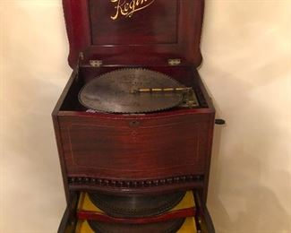 ANTIQUE REGINA MUSIC BOX with CABINET and DISCS