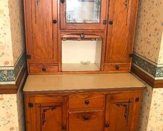 Antique Oak Hoosier Cabinet with sliding metal work surface.