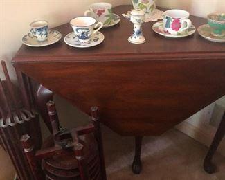 cool drop-leaf table supporting proper tea sets