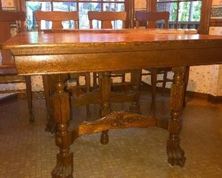 Monk table with four paws