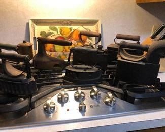 We have a collection of Antique / Vintage Irons; Coal Irons, Sad Irons, Volcan pressing irons, electric irons