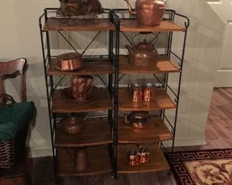 Wicker and rattan shelving with copper tea pot collection