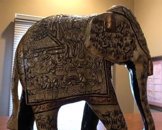 Ivory Blue Elephant Decorative Papier Mache Embossed Sculpture 13″H                                                       This ivory embossed Papier or Paper Mache elephant is the finest and highest form of Papier Mache art, which is very rarely done nowadays. Only the finest Papier Mache artisans indulge in creating such intricate art as it needs absolute dedication, skill, finesse and above all lot of time to complete such ornate object.It's hard to believe that these pieces begin as molded paper pulp. While the basic shape comes from a mold, the last layer before painting is freshly applied, and sculpted (or embosses) by hand. After passing through the hands of several artisans and craftsmen, each specializing in a specific layer of process, an object of exquisite beauty comes to life. These artisans have inherited the essential skills and aesthetic intelligence that it takes to fashion this art.