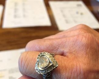 18k gold ring with an oval .35ct diamond and 20 diamonds surrounding with combined weight of .28 estimated