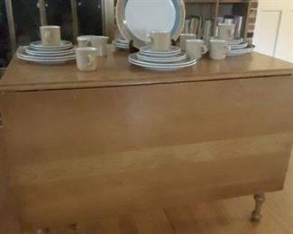 Maple drop leaf table has one leaf, in excellent condition.