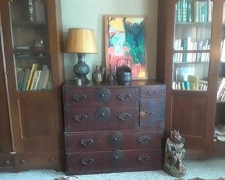 Tansu and vie of the pair of walnut bookcases. Lock is missing on the tansu