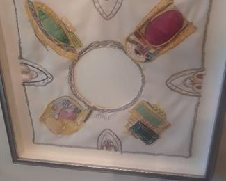 Rendering of Miye's various jewelry pieces form a pleasing composition that is framed as a work of art.