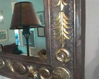 Interesting mirror with ornate metal frame
