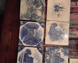 Tiles by Mintons, Wedgwood. Six blue and white, one sepia on ivory ground.