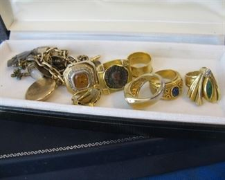 Assorted costume rings, one of a kind designs by Miye for her jewelry line Jantye and watch chain charm bracelet waiting to be displayed.