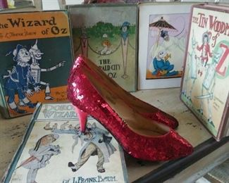 35 Wizard of Oz books and ruby slippers. Sold as a collection. Best offers will be contacted. Various dates and versions gong back to the 1940s. Shown are examples with more colorful covers.