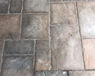 Driveway tiles in sand.