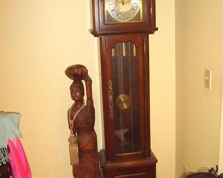 Moon phase grandfather clock and hand carved statue