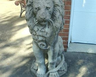 One of two vintage cement lions, standing about 44 inches high.