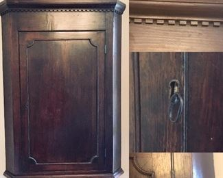 "18th Century Hanging Corner Cabinet-Cupboard, unique dentil  molding paired with Georgian influence. Beautiful scalloped shelves inside. Non-working lock. Condition is good, wear is consistent use and age. Warm, aged patina. Measurement is approximately 42""Hx32""Wx24""D"