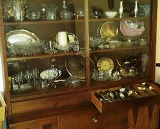 Vintage Stanley china hutch with barware, glassware and metalware.