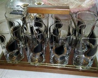 Vintage decorated barware in carry caddy.