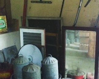 Vintage chicken waterers, Texaco gas can and assorted window frames.