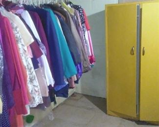 Vintage painted metal cabinet and women's clothing.