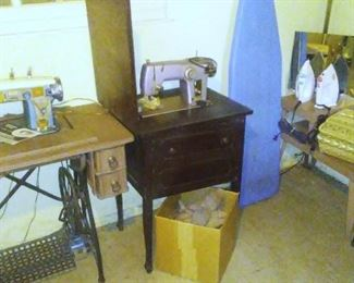 Two sewing machines and a collection of antique shoe-cobbling forms.