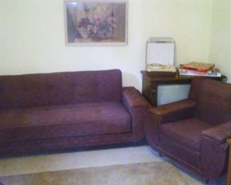 Vintage pull-out sleeper sofa with matching armchair.