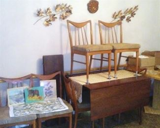 Vintage MCM Stanley Danish-style dining table with six chairs.