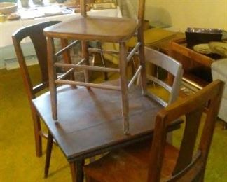 Assorted vintage chairs and table.