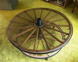 Vintage wagon wheel coffee table.