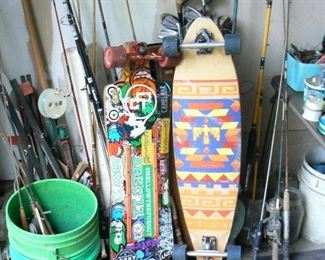 Vintage skateboards and fishing tackle.