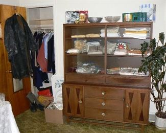 Vintage MCM Stanley Danish-style china hutch, household linens, and WW2 Russian-made leather trench-coat.