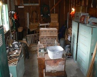 Rustic farm finds, bird caging, boxes and vintage painted cabinets.