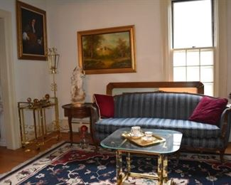 Area Rug,Candle Stand, Brass & Glass End Table, Statuary, Art, Oil Paintings, one by Mitchells, Brass Sconces, Tea Cups, Lg Wood Framed Mirror, Round Wood Scalloped End Tables, Vintage Sofa