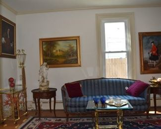 Overview of Parlor. Area Rug,Candle Stand, Brass & Glass End Table, Statuary, Art, Oil Paintings, one by Mitchells, Brass Sconces, Tea Cups, Lg Wood Framed Mirror, Round Wood Scalloped End Tables, Vintage Sofa