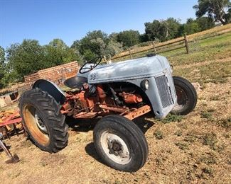 N8 Ford tractor with 3 pt hitch and implements.  RUNS great!!!