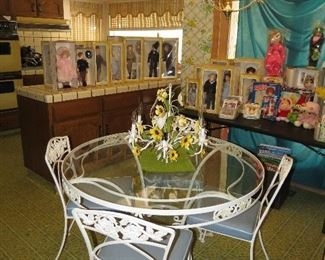 Vintage heavy rod iron table and four chairs.