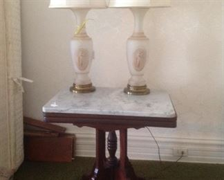 marble top table with pair of vintage lamps