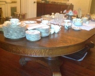 Tiger Oak extending banquet table & 8 chairs...extra leaves