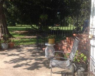 wrought iron chair & flower pots/pottery pots