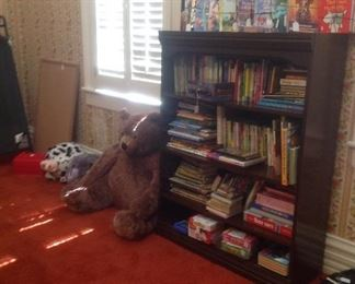 4 shelf wood bookcase filled with games & books