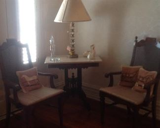 Marble top table, cane back chairs