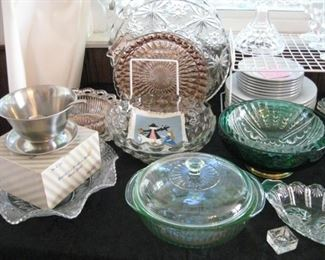 Serving platters, depression glass and green pyrex covered bowl