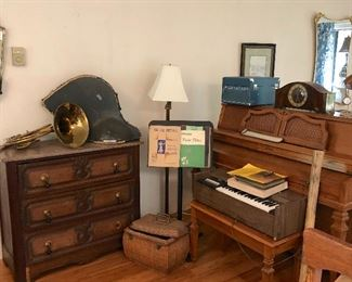 French horn, antique dresser with cool handles, missing one is in the drawer.