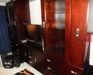 LOVELY BALCK ENTERTAINMENT CENTER COMES IN 3 SECTIONS