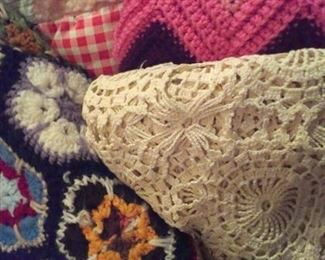 Selection of quilts, crocheted throws & crocheted tablecloth/bed cover