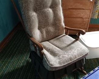 Classic wooden rocking chair with cushions. Nice!