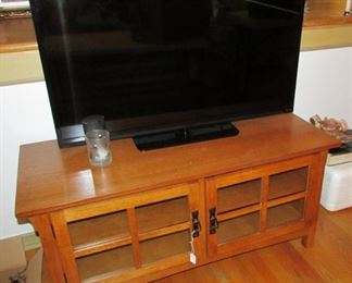Flat screen television and nice cabinet/stand