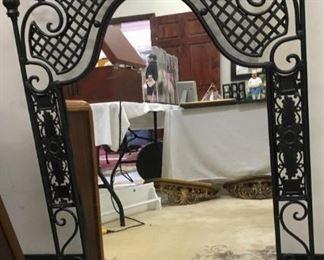 "Wrought iron framed mirror, 23.5"" x 43.25"""
